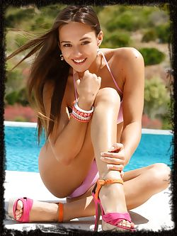 Poolside in her pink bikini and peep-toe stilettos,Dominika A is ready for naked fun in the sun