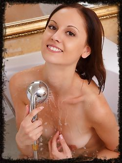 Sade Mare delightfully poses in the bathroom as she shows off her sexy, wet body.