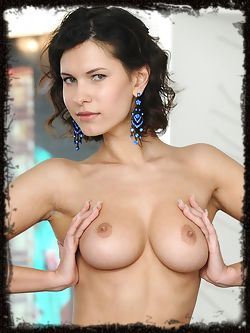 Suzanna A poses for the camera and shows off her assets