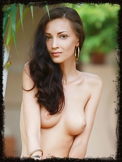 The ravishing Anna AJ enjoying a passion fruit smoothie in the garden, feeling the refreshingly cool wind on her naked body.
