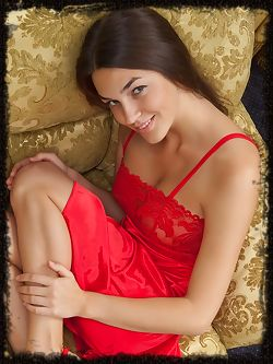 Vanda wears a bright red dress and matching stiletto shoes that suggests passionate love and lusty desires.