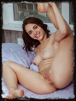 With a sweet smile, Mercedes shows off her bare body and nubile assets with wide open poses