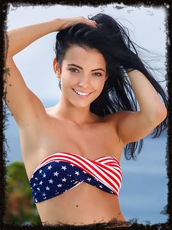 A gorgeous Sapphira A wearing an American flag shirt with matching printed panty, posing by the pool and showing off her gorgeous bod.