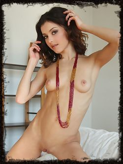 Divina A's womanly allure with tight assets, especially her puffy breasts, slim waist, and perfectly toned rump.