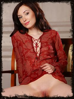 Halena A lovely raven haired beauty posing naked on her sriped loveseat