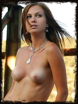 Ingret has brown hair and blue eyes, she has great breast bulging and wanting to be squeezed.