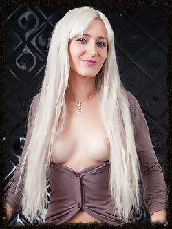 Janelle B has long platinum hair and a tight body