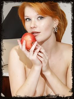 Mia Solis embraces her natural beauty as she lounges in her bed reading a book and eating an apple. Her body perfect and poised, exposing her natural assets for you to admire She is a classic, redheaded beauty that can fuel any man's sexual desire.