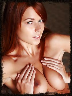 New model with Long red hair with wide hips a trimmed bush , she is ultra relaxed.