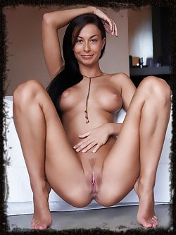 Perfect silky long black hair caresses full breasts with puffy nipples on this tanned goddess.