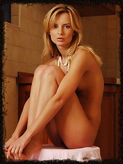Stripping off her simple dress to show her long legs and toned figure and small soft breasts.